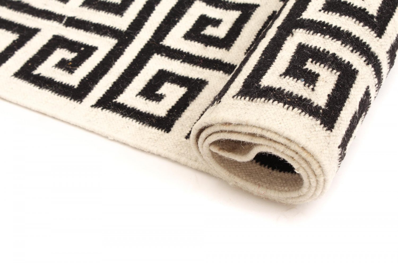 Wool rug gournia black white wool rugs for Black and white wool rug